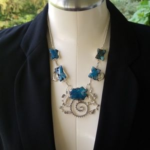Silver chunky necklace with natural stones.